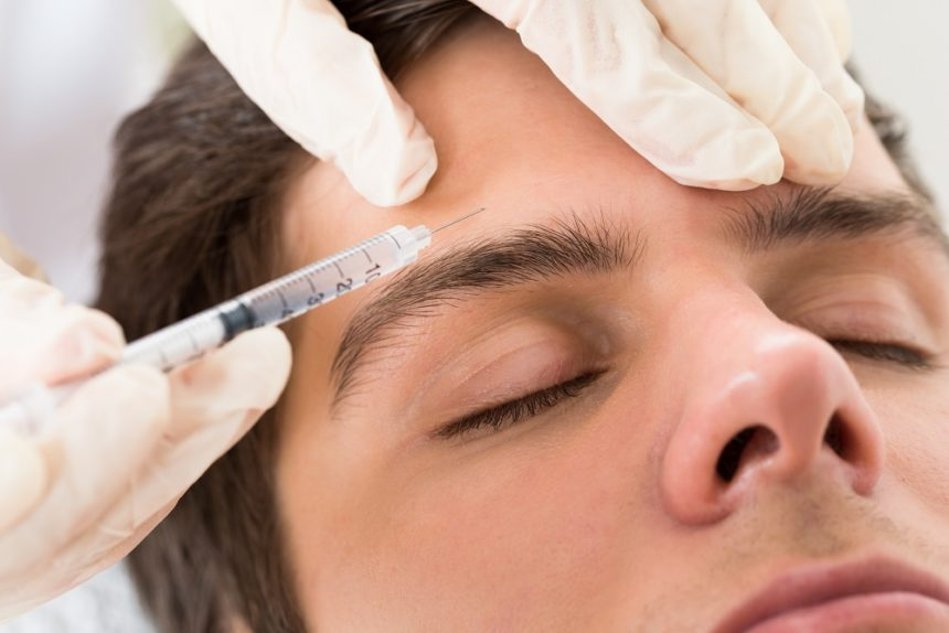 man getting botox injection