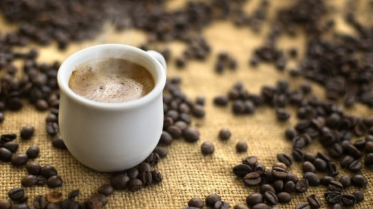 cup of coffee with coffee bean background