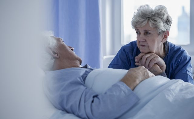 woman in hospital visiting husband