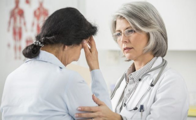 A physician speaking to a patient