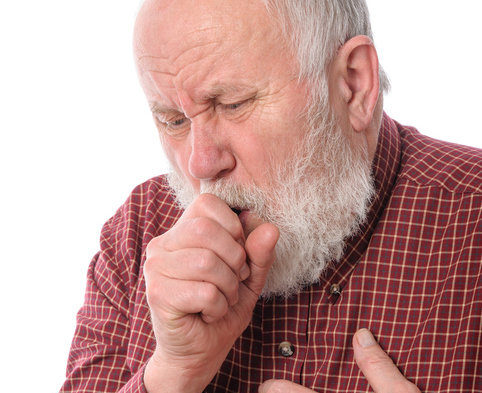 older man coughing into hands