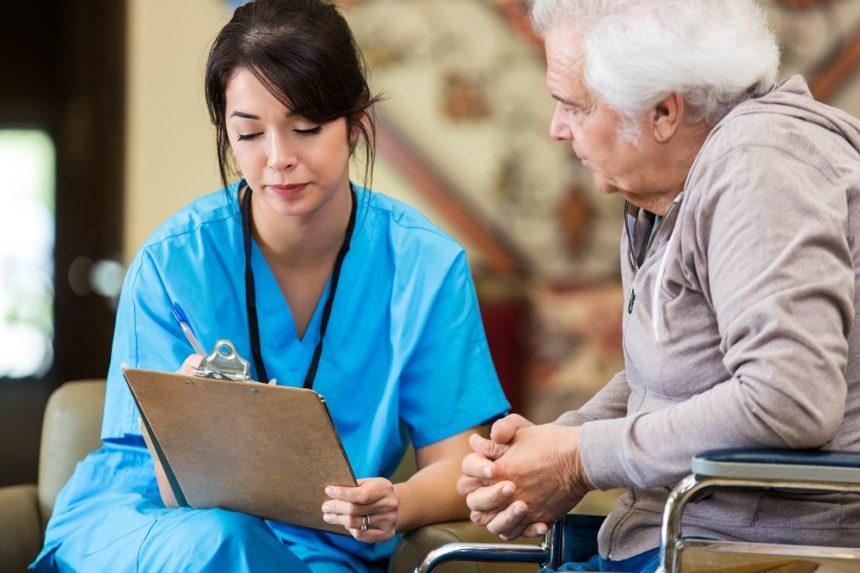 nurse talking to older patient