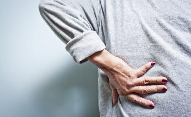 woman back pain elderly