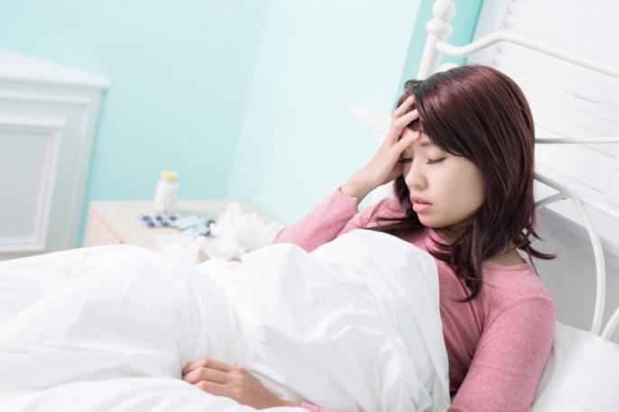woman sick sleep tired