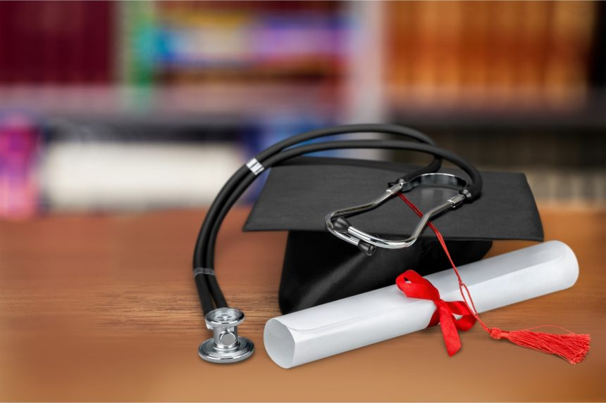 diploma and stethescope