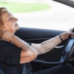 older woman behind the driver's wheel
