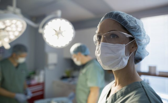 female surgeon operating room surgery