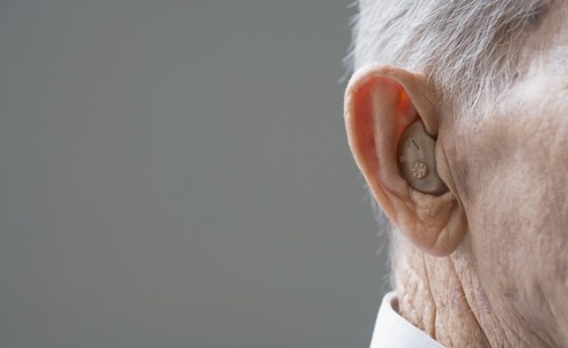 closeup of man's hearing aid