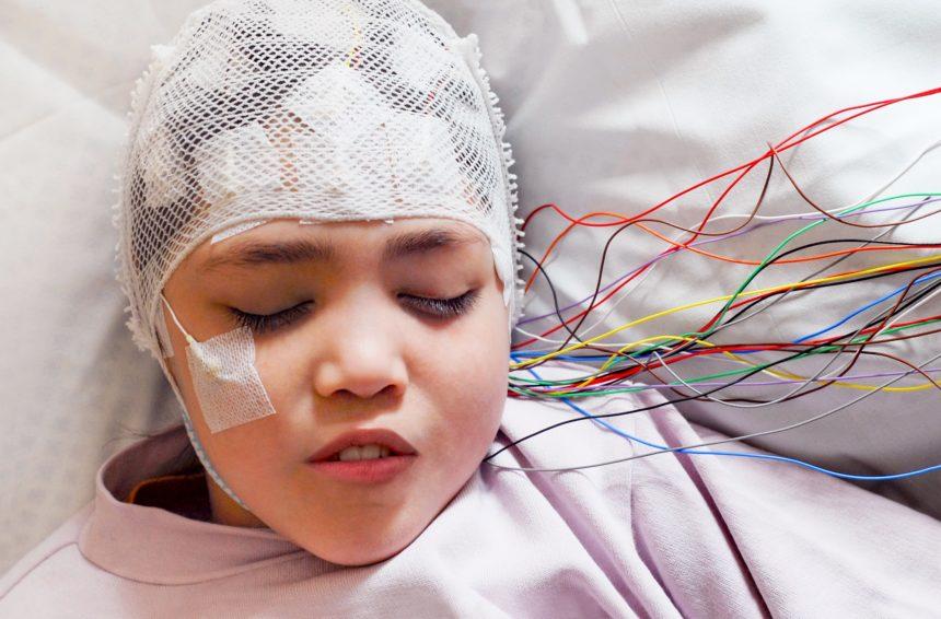 Girl hooked up to EEG machine