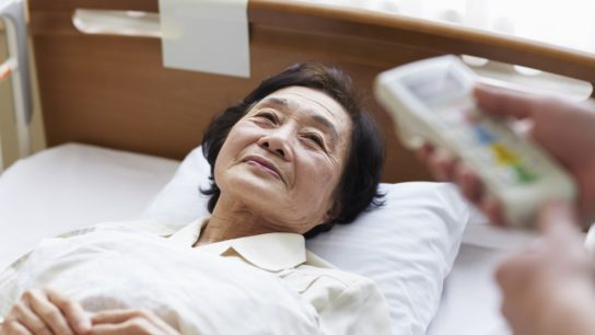 older woman in inpatient bed