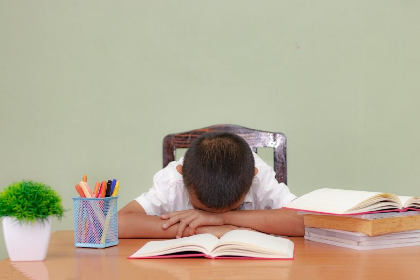 Child who has fallen asleep at a desk.