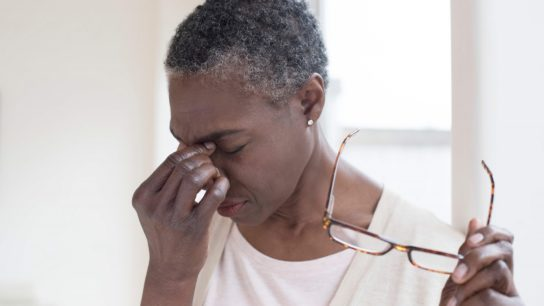 A woman suffers from a migraine headache.