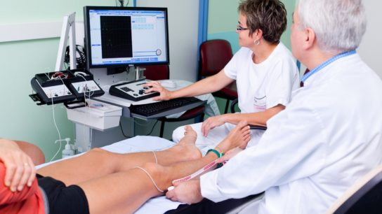 doctor using an electromyography