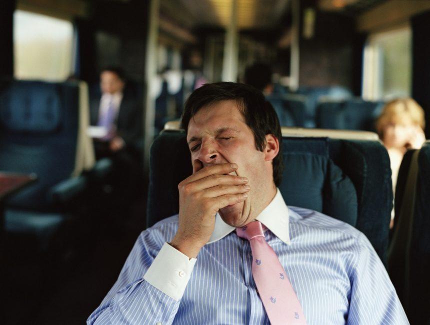 businessman yawning on train, sleepiness, tired, OSA