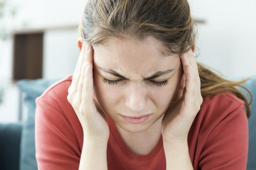 young woman with migraine, headache pain