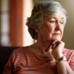 sad elderly woman, pondering