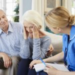 older couple with a health care worker