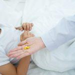 child taking medication, pills