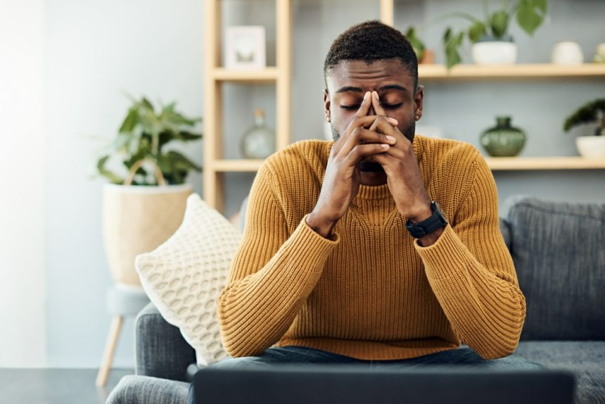 young man with headache, migraine, stress
