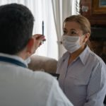 Doctor examining a patient's sight during a house call